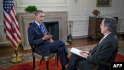 Başkan Barack Obama Beyaz Saray'da muhabirimiz Andre de Nesnera'nın sorularını yanıtlıyor