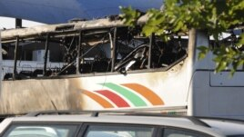 A burnt bus is seen at Bulgaria's Burgas airport July 18, 2012. At least three people were killed and more than 20 injured by an explosion on the bus carrying Israeli tourists Wednesday outside the airport of the Black Sea city.