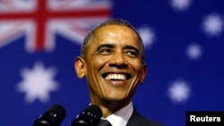 President Barack Obama smiles broadly as he takes the stage to speak at the University of Queensland in Brisbane, Australia, Nov. 15, 2014. Obama was in Brisbane for the G20 Summit.