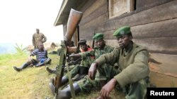 M23 rebel fighters in Karambi, eastern Democratic Republic of Congo (DRC) July 12, 2012.