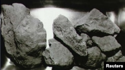 FILE: Scientists are studying the composition of lunar rocks, such as these brought back by Apollo 11 astronauts.