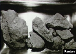 Scientists are studying moon rocks, such as these brought back by Apollo 11 astronauts.