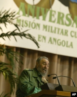 FILE - Fidel Castro, gestures while talking during an evening ceremony marking the 30th anniversary of Cuba's military mission in Angola, Dec. 2, 2005 in Havana.