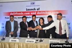 Chandra Bhan Prasad (second from right) at a function to launch Dalit Foods, which he hopes will help to end caste-based discrimination, New Delhi, July 2, 2016. (Courtesy photo from Dalit Foods)