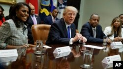 FILE - President Donald Trump speaks during a meeting on African American History Month in the White House in Washington, Wednesday, Feb. 1, 2017. Attending the meeting was Omarosa Manigault. (AP Photo/Evan Vucci)