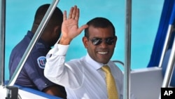 FILE - Maldives former president Mohamed Nasheed as he is taken back to Dhoonidhoo prison after a court dismissed his appeal against his arrest in Male, March 2015.
