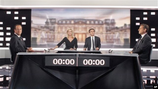 Socialist Party candidate for the presidential election Francois Hollande, left, and current President and conservative candidate for re-election Nicolas Sarkozy , right, pose before a televised debate in Paris,  May, 2, 2012.