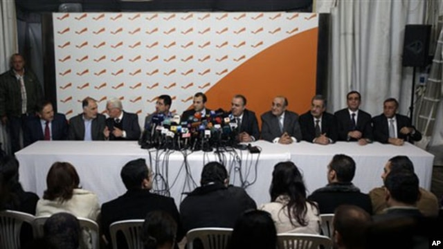 From left: Lebanese Ministers Ali Abdallah, Mohammed Fneish, Abraham Dedeyan, Hussein Hajj Hassan, Jibran Bassil, Mohammed Jawad Khalife, Fady Abboud, Charbel Nahhas, Youssef Saade and Ali Shami hold a press conference to announce their resignation in the