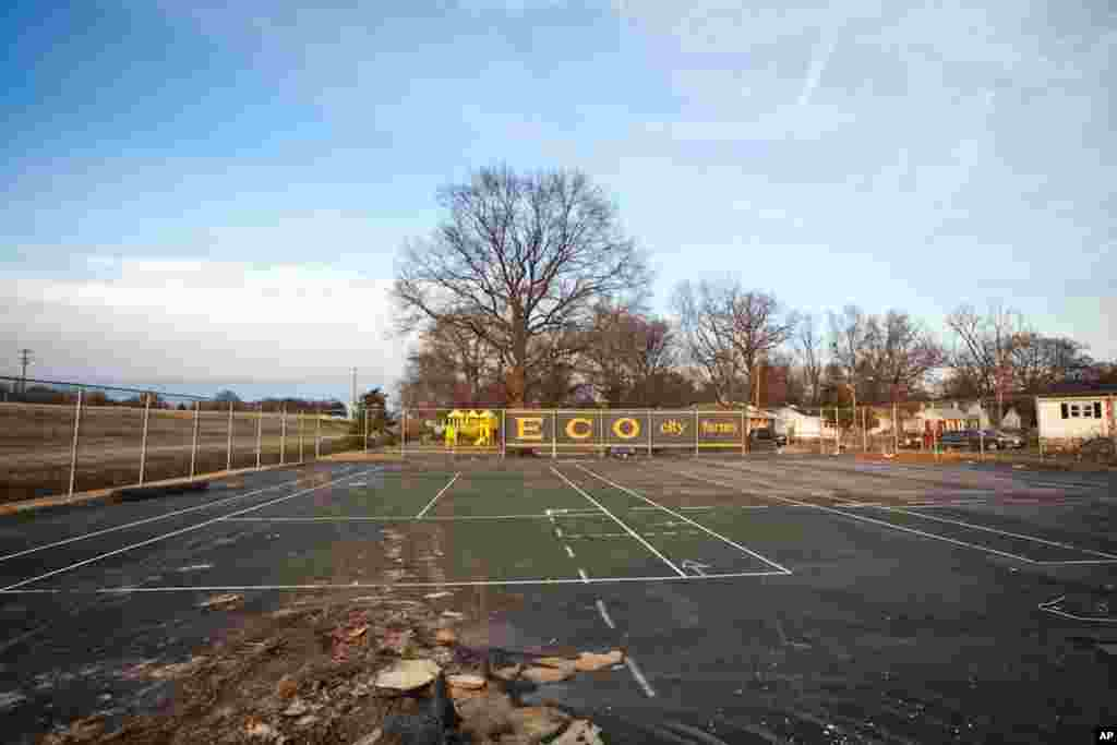 The farm plans to build more hoop greenhouses, a food shed kitchen, and a small orchard on this abandoned tennis court. (Alison Klein/VOA)