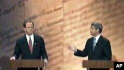 西斯塔克(右)与图米电视辩论