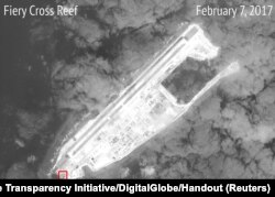 A satellite image shows what CSIS Asia Maritime Transparency Initiative says appears to be concrete structures with retractable roofs on the artificial island Fiery Cross reefs, South China Sea, in this image released on February 22, 2017.