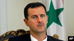 FILE - Syrian President Bashar Assad, Aug. 19, 2009.