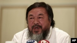 Chinese activist and artist Ai Weiwei addresses journalists during a news conference in Athens, Friday, Jan. 1, 2016. The Chinese artist visited the island of Lesbos is solidarity with refugees and migrants who continue to arrive on a daily basis hoping to make their way into Europe.