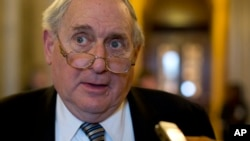 "FILE - Now retired senator Carl Levin is seen speaking with reporters on Capitol Hill in Washington, Feb. 26, 2013. He says public anger over the Panama Papers offers an opportunity to ""make real progress"" in ending financial abuses."
