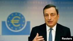 FILE - European Central Bank President Mario Draghi addresses the monthly ECB news conference in Frankfurt.