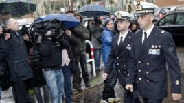 Italian marines Salvatore Girone (L) and Massimiliano Latorre arrive at a military prosecutor's office in Rome, March 20, 2013.