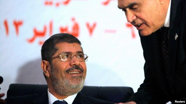 Egyptian President Mohammed Morsi (l) February 6, 2013.