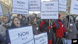 Members of the Church of Scientology, protest outside Paris courthouse in Paris, Feb. 2, 2012.
