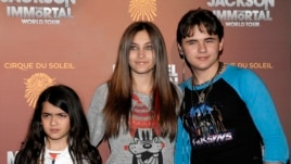 FILE - This Jan. 27, 2012 file photo shows, from left, Blanket Jackson, Paris Jackson, and Prince Michael Jackson at the opening night of the Michael Jackson The Immortal World Tour in Los Angeles.