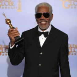 Actor Morgan Freeman poses backstage with the Cecil B. Demille Award during the 69th Annual Golden Globe Awards Sunday, Jan. 15, 2012, in Los Angeles