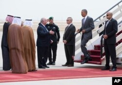 U.S. President Barack Obama is greeted by Ambassador Joseph Westphal, U.S. Ambassador to the Kingdom of Saudi Arabia, as he arrives on Air Force One at King Khalid International Airport in Riyadh, Saudi Arabia, April 20, 2016.