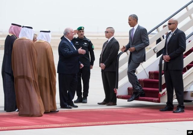 U.S. President Barack Obama is greeted by Ambassador Joseph Westphal, U.S. Ambassador to the Kingdom of Saudi Arabia, as he arrives on Air Force One at King Khalid International Airport in Riyadh, Saudi Arabia, April 20, 2016.
