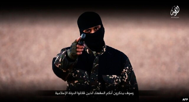 image grab taken from a video published by the media branch of the Islamic State (IS) group in the Raqa province (Welayat Raqa) on Jan. 3, 2016, purportedly shows an English-speaking IS fighter speaking to the camera at an undisclosed location.