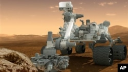 This artist's rendering provided by NASA shows the Curiosity rover on the surface of Mars. (AP/NASA)