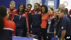First lady Michelle Obama poses with members of Team USA, 2012 Summer Olympics, London, July 27, 2012.