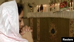 A Christian girl prays in Rawalpindi. Pakistan.