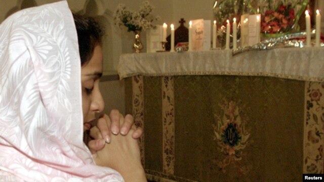 A Christian girl prays in Rawalpindi. Pakistan.