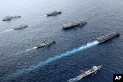 British, Canadian and Japanese vessels sail together in the Pacific Ocean on Septemebr 2021. The U.S. and its allies are becoming assertive in their approach toward a rising China. (UK Ministry of Defence via AP)