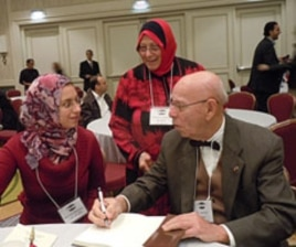 Professor Ibrahim Oweiss answering questions from conference participants