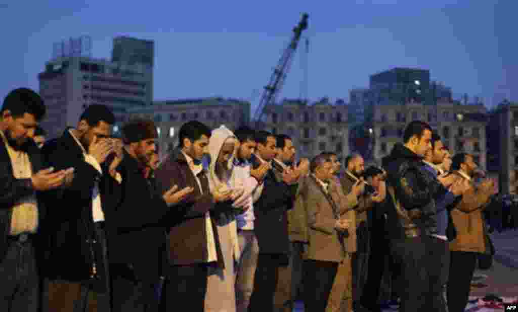 Muslim anti-government protesters make their prayers at dusk at the continuing demonstration in Tahrir square in downtown Cairo, Egypt, Tuesday, Feb. 1, 2011. More than a quarter-million people flooded into the heart of Cairo Tuesday, filling the city's m