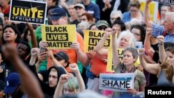 People protest in support of Philando Castile during a rally on the capitol steps after a jury found St. Anthony Police Department officer Jeronimo Yanez not guilty of second-degree manslaughter in the death of Castile, in St. Paul, Minnesota, June 16, 20