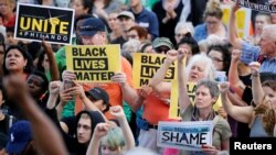 People protest in support of Philando Castile during a rally on the capitol steps after a jury found St. Anthony Police Department officer Jeronimo Yanez not guilty of second-degree manslaughter in the death of Castile, in St. Paul, Minnesota, June 16, 2017.