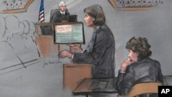 In this courtroom sketch, defense attorney Judy Clarke is depicted addressing the jury as defendant Dzhokhar Tsarnaev, right, sits during closing arguments in Tsarnaev's federal death penalty trial, April 6, 2015, in Boston.