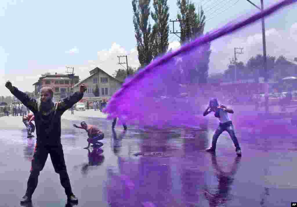 Police use colored water to disperse Kashmiri government employees during a protest in Srinagar, India. Police detained dozens of government employees during the protest demanding regularization of contractual jobs and a hike in salary.