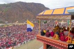 FILE - Tibetan spiritual leader the Dalai Lama delivers teachings at the Thupsung Dhargyeling Monastery in Dirang, Arunachal Pradesh, India, April 6, 2017.