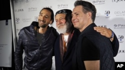 Actor Adrien Brody, from left, photographer Bruce Weber and Jason Binn pose for a photo during the annual Art Basel kick-off party in Miami Beach, Florida, Dec. 1, 2015.