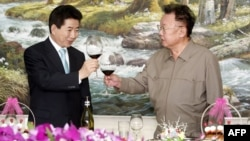 FILE - South Korean President Roh Moo-Hyun, left, and North Korean Leader Kim Jong-Il toast after signing the peace declaration during the two Korea Summit in Pyongyang, North Korea, Oct. 4, 2007.