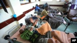 FILE - Cholera patients lie in beds in Budiriro clinic in Harare, Zimbabwe. A cholera emergency has been declared in Harare after 20 people have died.
