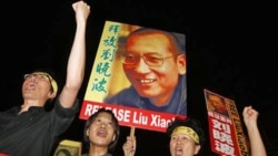 Protesters in Hong Kong call for the release of Chinese dissident Liu Xiaobo Friday