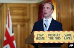 Britain's Foreign Secretary Dominic Raab delivers a speech during a coronavirus briefing in Downing Street, London, April 6, 2020, in this photo provided by 10 Downing Street.