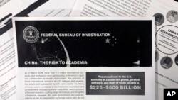 Pamflet dan email dari Biro Penyelidik Federal AS (FBI) untuk perguruan tinggi memperingatkan bahaya spionase ekonomi, terutama dari China, 4 Oktober 2019.