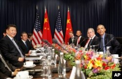 U.S. President Barack Obama, right, with China's President Xi Jingping, left, and members of their delegations, during their meeting as part of the Asia-Pacific Economic Cooperation (APEC) in Lima, Peru, Nov. 19, 2016.