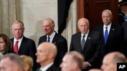 From left, former Vice President Dan Quayle, former Secretary of State James Baker III, former Vice President Dick Cheney, and former Secretary of State Colin Powell, arrive at the Capitol Rotunda in Washington, to attend a memorial service for former President George H.W. Bush