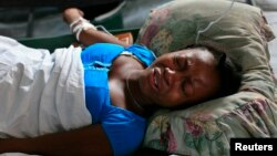 A Haitian infected with cholera grimaces in pain in a clinic set up by the International Red Cross in Port-au-Prince December 11, 2010.