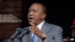 FILE - Kenyan President Uhuru Kenyatta delivers a speech at the Nyayo National Stadium in Nairobi, Oct. 20, 2014.