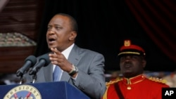 FILE - Kenya President Uhuru Kenyatta delivers a speech during Mashujaa Day -- also known as Heroes Day -- at the Nyayo Nationa Stadium, in Nairobi, Kenya, Oct. 20, 2014.